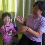 Ling playing with her caregiver